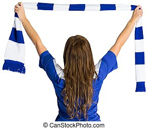 Pretty football fan waving scarf on white background