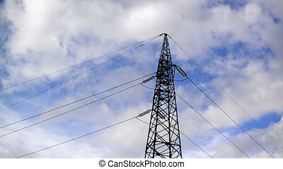 High voltage electric power pylon and lines with time lapse...