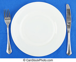 Knife, white plate and fork