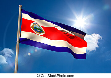 Costa rica national flag on flagpole on blue sky background