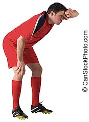 Tired football player bending over on white background
