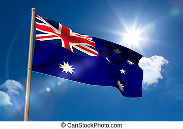 Australia national flag on flagpole on blue sky background