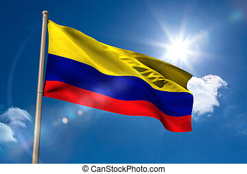 Colombia national flag on flagpole on blue sky background
