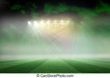 Football pitch under green sky and spotlights - Digitally...