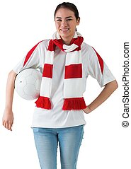 Football fan in white wearing scarf holding ball on white...