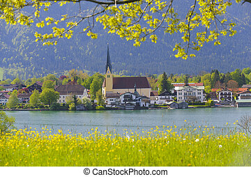 lake Tegernsee in Bavaria with church of city Rottach-Egern