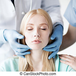 plastic surgeon or doctor with patient - healthcare, medical...