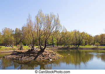 lake with an island - MOSCOW - May 2014: Spring in the...