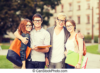 group of students or teenagers hanging out - summer...