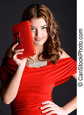 clutch bag - Stunning young woman with long curly hair...