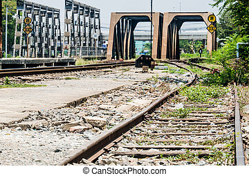 old railroad track with the bridges in urban area