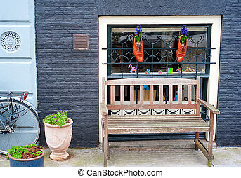 Bench in Amsterdam - Wooden bench on the street of...