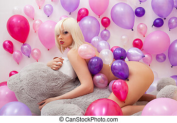Flirty nude blonde lying on big teddy bear - Image of flirty...