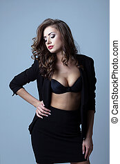 Sensual busty woman posing in business suit - Image of...
