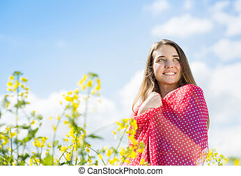 Girl in colza field - Happy young girl with red scarf...