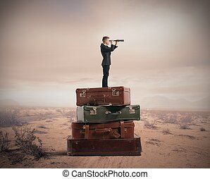 Travel - Concept of travel with businessman with binocular