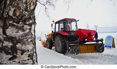 Snow-plough vehicle working at festival site - PETROZAVODSK,...