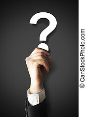 businessman holding question mark in hand