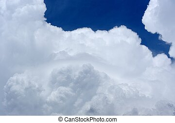 White Clouds in Blue Sky - Puffy white clouds in a blue sky
