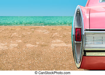 Vintage pink car on the beach