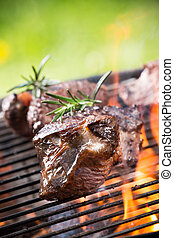 Grilled beef steaks on the grill. - Grilled beef steaks on...