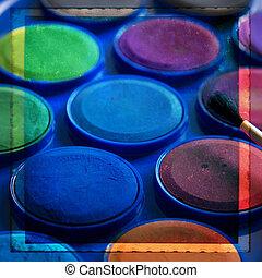 Watercolors paint box and brushe on a texture retro