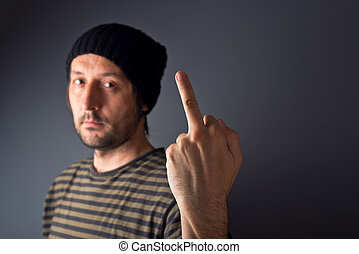 Punk giving middle finger, rude gesture - Punk male is...