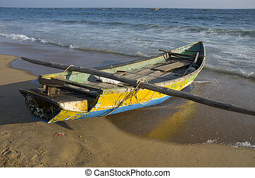 wooden fishing boat on Bengal sea beach in Tamilnadu, India...