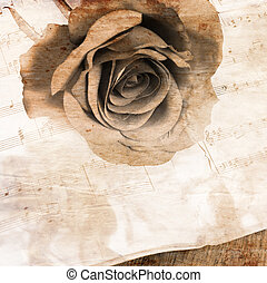 The rose on notebooks with notes - The rose on notebooks...