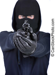 Criminality - Bandit in mask with weapon isolated on white...