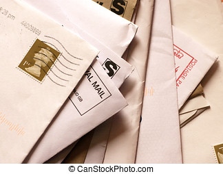 Mail awaits attention - A pile of business mail in unopened...