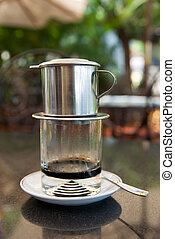 Vietnamese style coffee - Coffee brewed in traditional,...