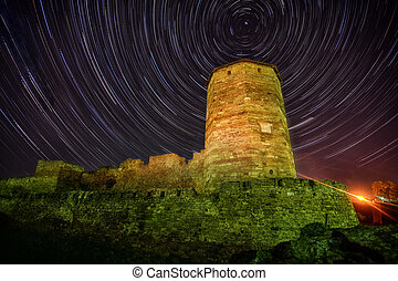 Old stone tower on starry night skyes background lighthouse...