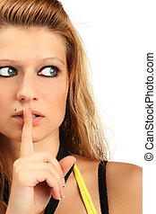 Shhh - Blonde woman holding her finger to her lips