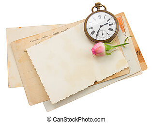 bunch of old papers with antique clock