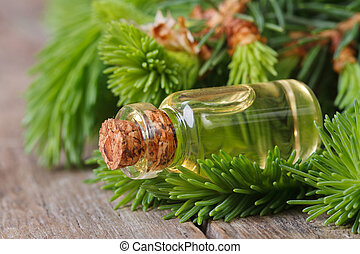 aromatic oil of spruce and young branches closeup on a...
