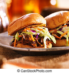 two barbecue pulled pork slider sandwiches