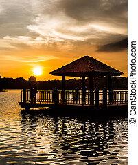 Water Gazebo and Sunset - Water gazebo and sunset at a lake...
