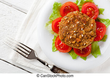 Lentil Burger - Vegetarian Lentil Burger with Tomatoes and...
