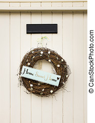 Home Sweet Home sign on a door - Home Sweet Home sign on a...