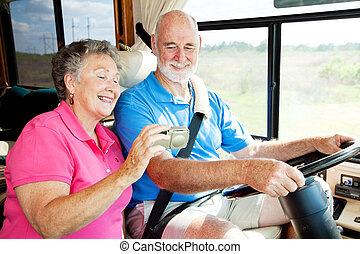 RV Seniors with GPS - Senior couple using GPS to navigate...