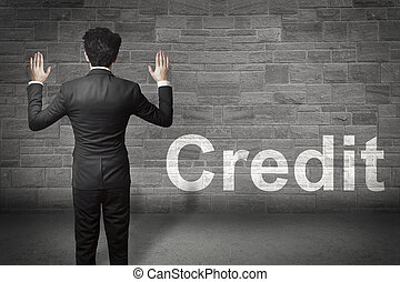 businessman hands up wall credit - businessman standing in...