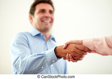 Adult charming businessman giving hands greeting