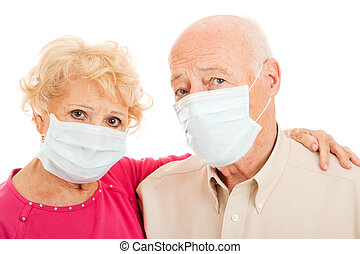 Epidemic - Swine Flu Seniors - Senior couple wearing face...