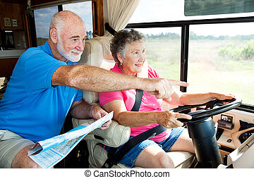 RV Seniors - Point the Way - Senior couple traveling in...