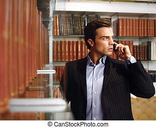 handsome business man - A handsome business man at his...