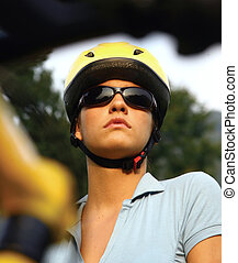 bicyclist - portrait of a young female in a cycling helmet...