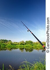 Fishing Rod Spinning Rod over Lake - A fishing rod over a...