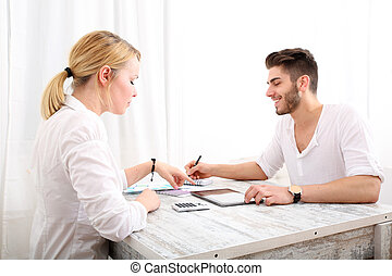 Young couple and financial planning - A happy young couple...