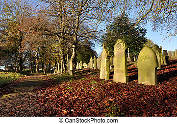 Autumn Graveyard - Traditional English graveyard on a sunny...